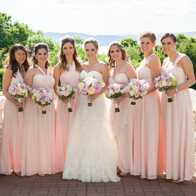 Lindsay's six bridesmaids wore romantic blush Jenny Yoo dresses with various necklines.