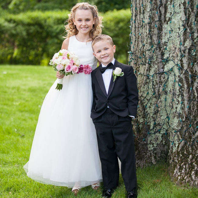 The flower girl looked adorable in a long white a-line dress with a pink floral belt and a smaller bouquet to match the bride's. The ring bearer matched the groomsmen in a black tuxedo with a black bow-tie.