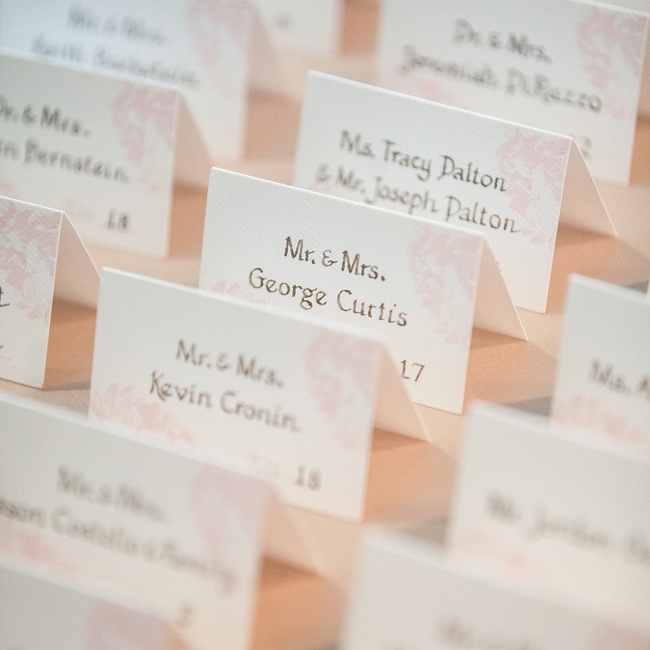 Lindsay and Mark had small escort cards displayed at the front table with pale pink designs in the corner.