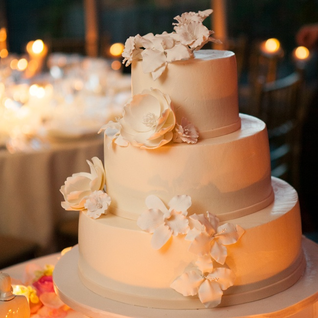 The wedding cake, designed by Abigail Kirsch, was three-tiered and featured beautiful fondant flowers on each level.