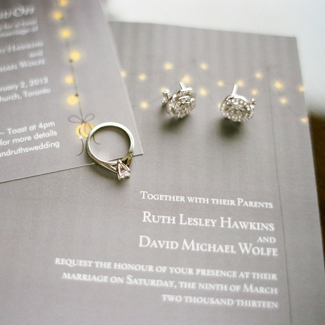 Strings of bistro lights brightened up the striped, gray invitations.