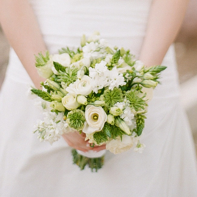 Ruth's bright spring bouquet was filled with white and green blooms like ranunculuses, stock, spider mums and roses.