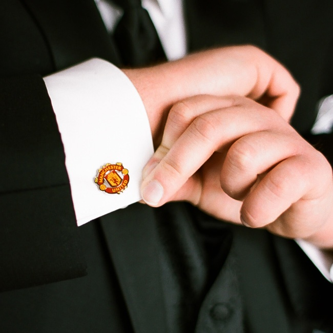 David showed some team pride with a pair of Manchester United cuff links.