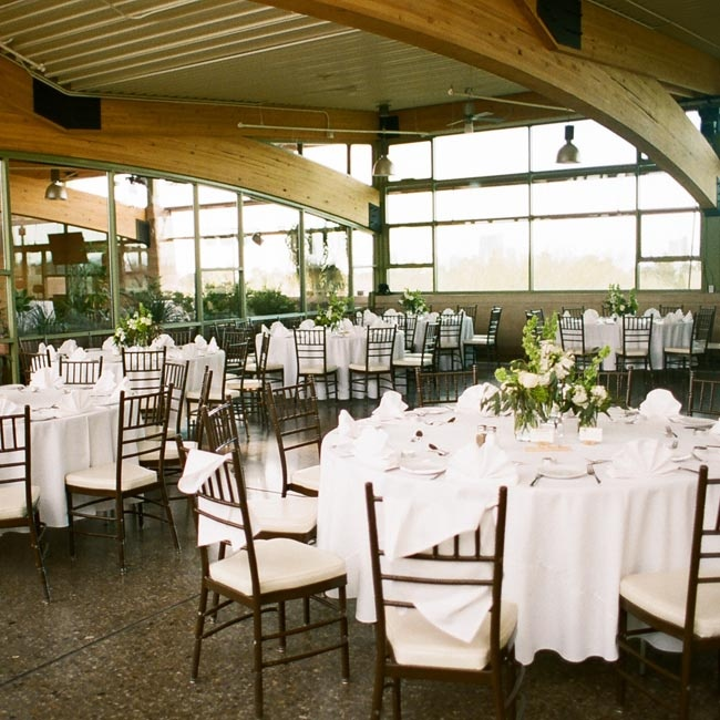 The reception was held in the Gardens Terrace banquet room at Springs Preserve. The unique space was given an elegant touch with crisp, white linens and sophisticated floral arrangements.
