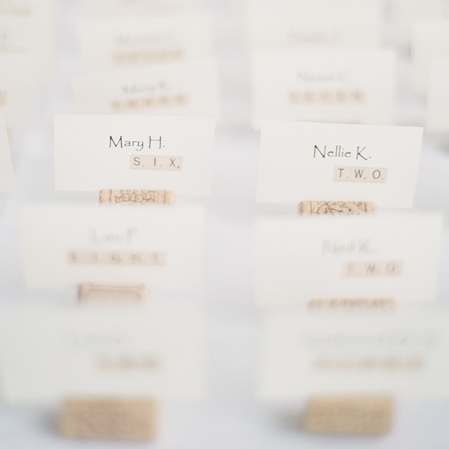 The cream-colored escort cards had a fun scrabble motif and were set in wine corks.