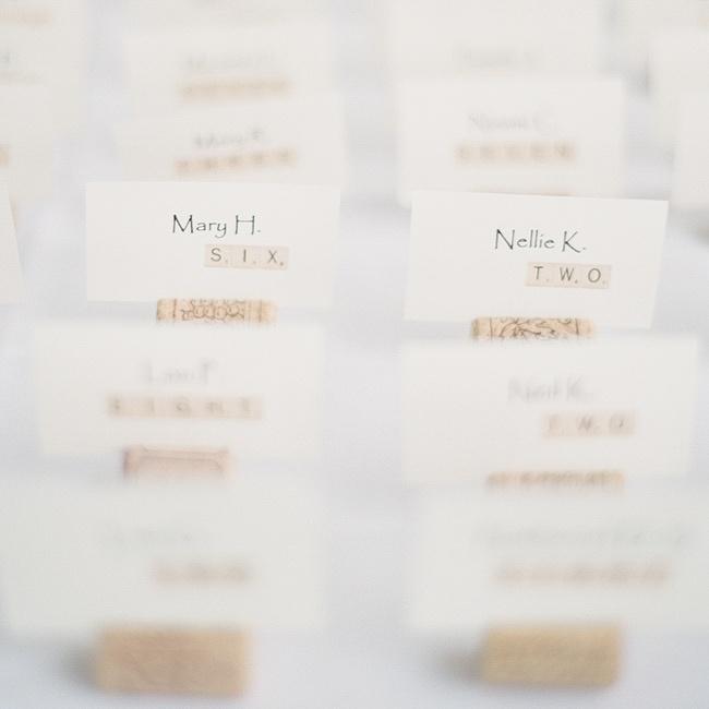 The cream-colored escort cards had a fun scrabble motif and were set in wine corks.