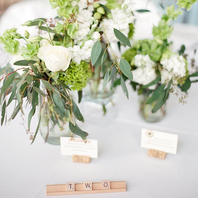 Ruth and David put a fun spin on the table numbers, using scrabble blocks to spell out each number.