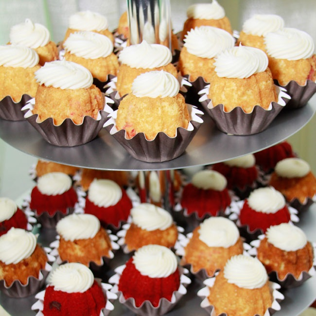Instead of traditional cake, the couple served miniature bunt cakes  in delicious flavors like red velvet, pecan praline and white chocolate raspberry.