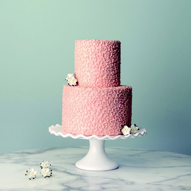 A design in buttercream adds texture to this simple two-tier cake.