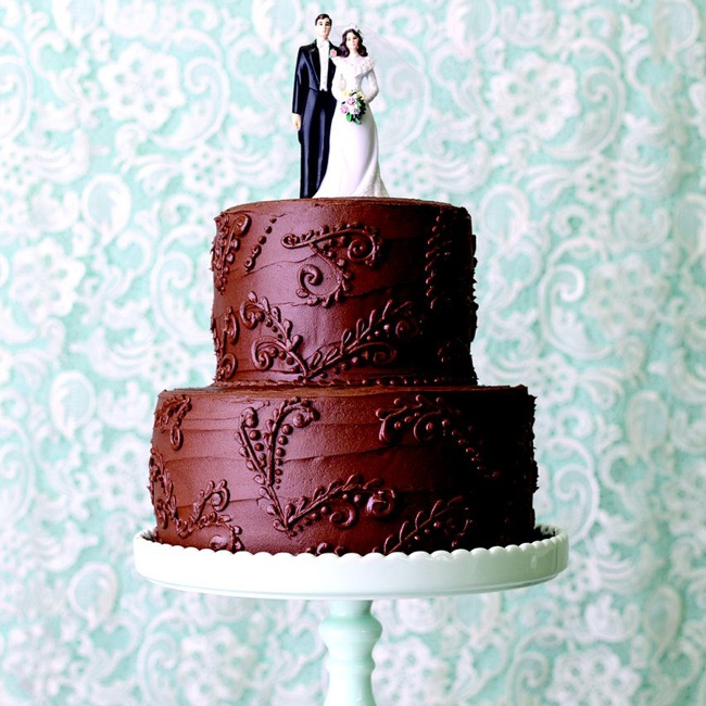 An understated chocolate cake was topped with a classic bride and groom cake topper.