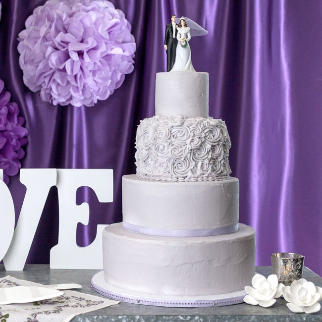 A rosette covered tier added a romantic touch to this lavender hued cake.