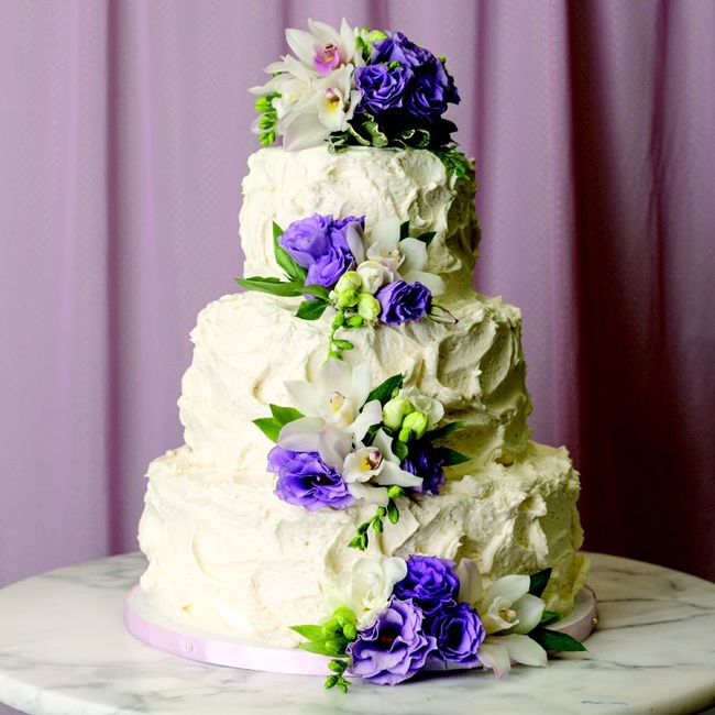 Buttercream frosting gives this pretty flower-covered cake a textured finish.