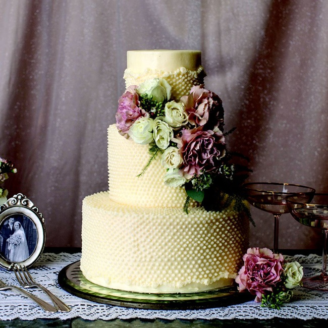 A swiss dot detail and ruffle finish give this cake a vintage feel.