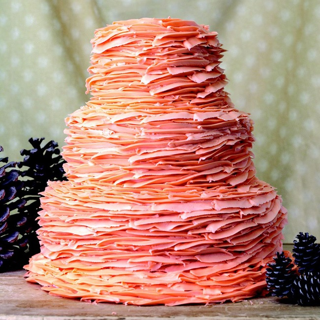 There's no topper needed for this cake covered in feathered layers of buttercream in coral and peach hues.