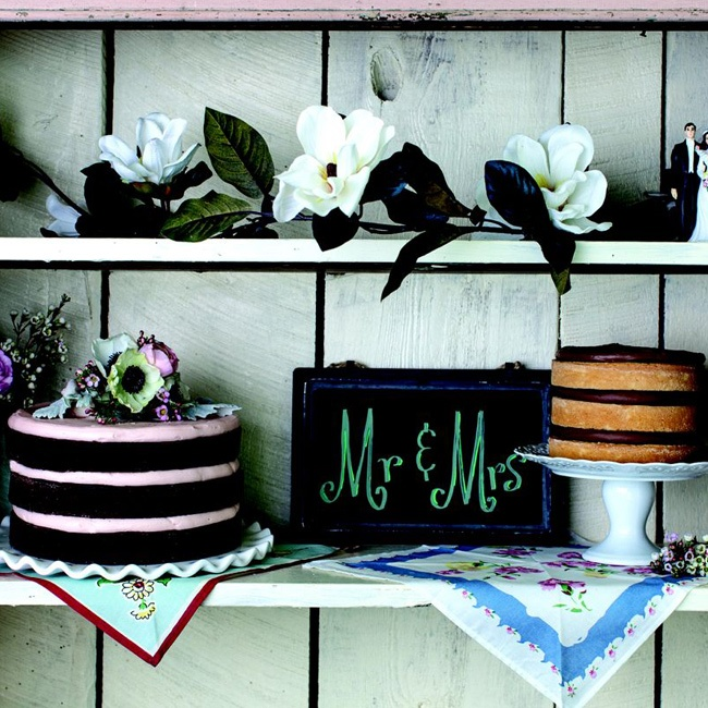 A display of naked cakes is a modern alternative to the traditional frosted cake.