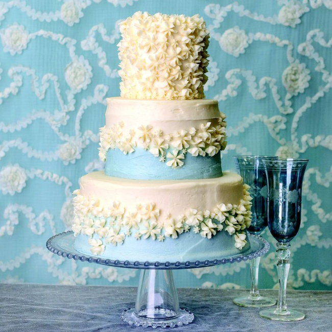 Iced flowers add texture to a pretty sky blue cake.