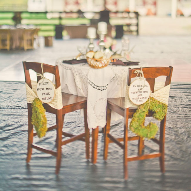 The couple's chairs were decorated with moss letters, floral fabric and lyrics from Johnny Cash and Miranda Lambert songs.