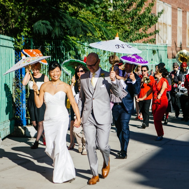 Following the ceremony, the couple and their guests paraded around the neighborhood accompanied by the Hungry Man Marching Band who supplied the lively tunes.