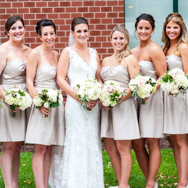 Christina wanted to make sure that her accents were neutral, because her venue's carpet and styling was very blue. Her bridesmaids wore tan Jenny Yoo dresses to the celebration.