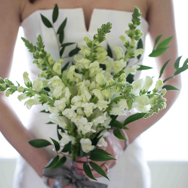Shannon carried a simple bouquet of white stock flowers accented by deep green leaves.