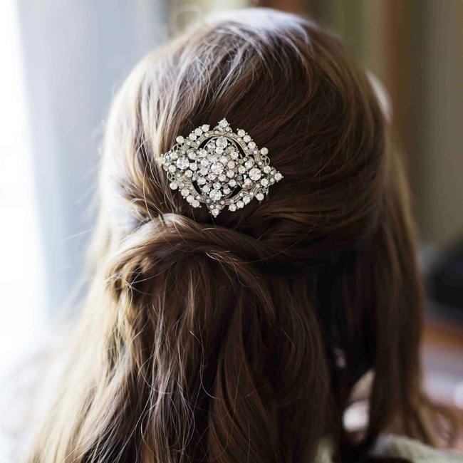 A crystal barrette added a hint of sparkle to Shannon's classic half-up hair style.