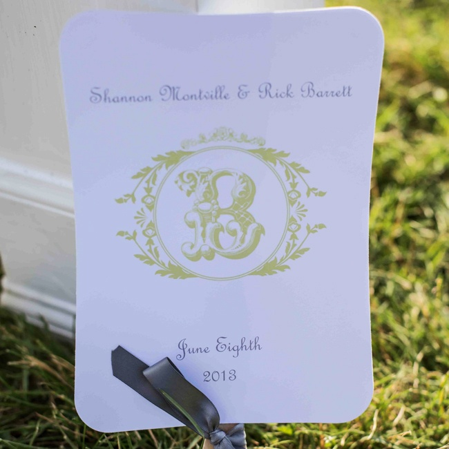 The programs were in a fan style with a decorative monogram in gold ink and gray satin bows.