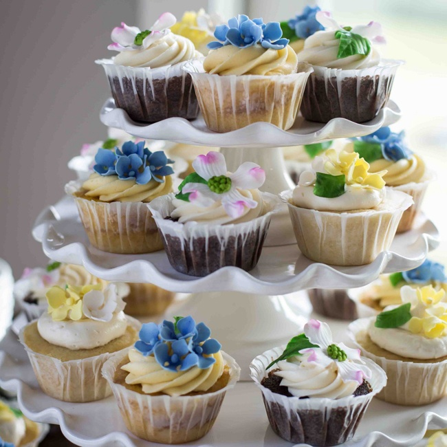 Shannon, Rick and their guests enjoyed Peach Cobbler, Raspberry Almond Joy, and Triple Chocolate cupcakes, each decorated with colorful sugar flowers.