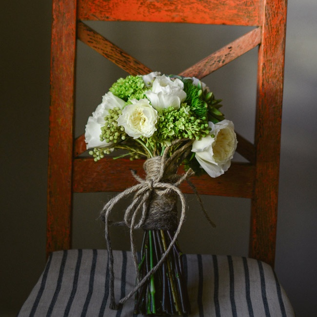 The bridal bouquet was filled with green and white blooms, including peonies and roses.