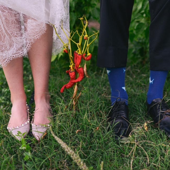 The groom accessorized with blue shark-themed socks while the bride wore edgy, studded nude Valentino flats.