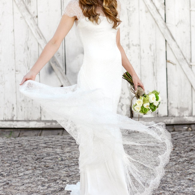 Lisa's flowy, lace Marchesa gown was the perfect complement to her laid-back nuptials.