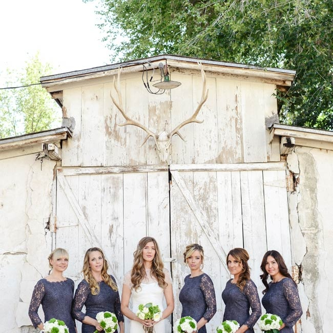 Bridesmaids wowed in these lace, dark slate dresses by Diane Von Furstenberg.