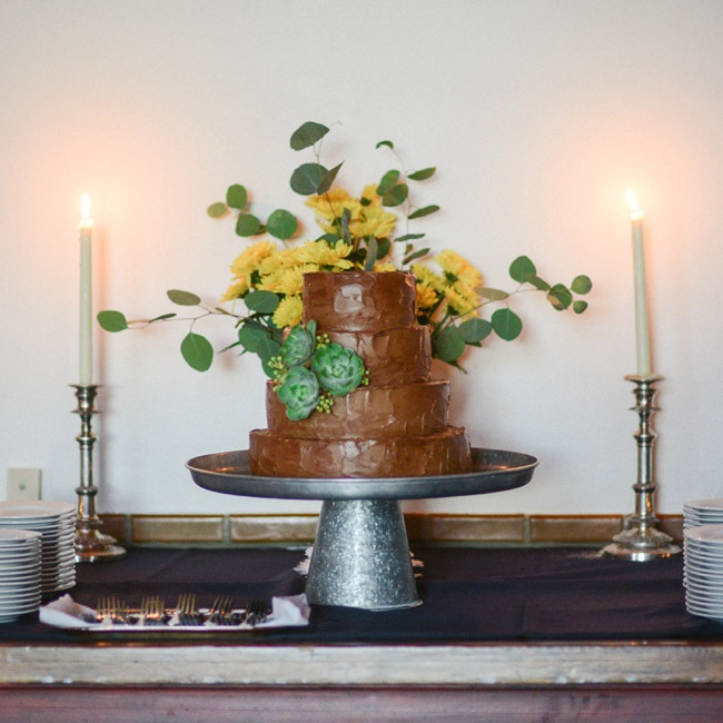 The beautiful chocolate frosted cake was made by the venue, Los Poblanos, and topped with fresh eucalyptus leaves and yellow flowers.