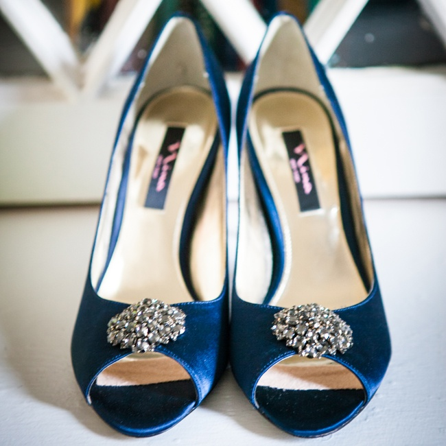 Jenn walked down the aisle in a pair of navy peep toes heels with crystal brooches.