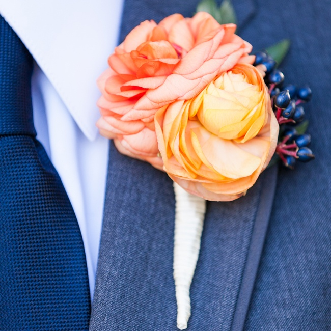 James's bright peach and coral boutonniere popped against dark gray suit.