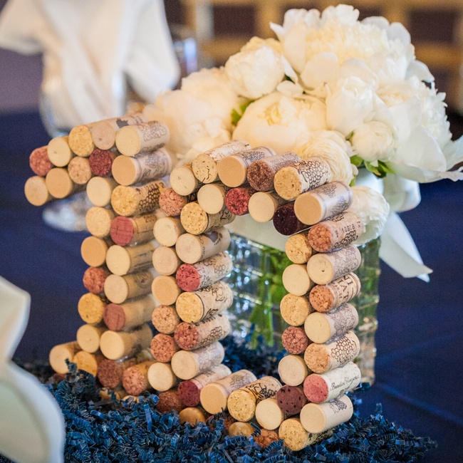 The table numbers were made from wine corks, complementing the wedding's vineyard locale.