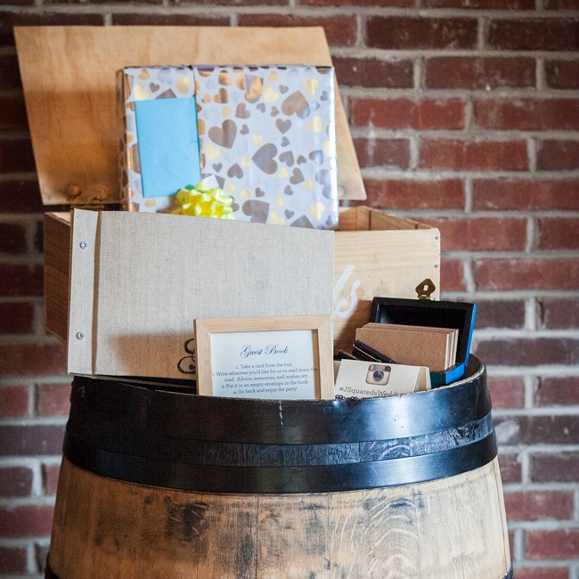 A wine barrel was used to display the couple's guestbook and card box.