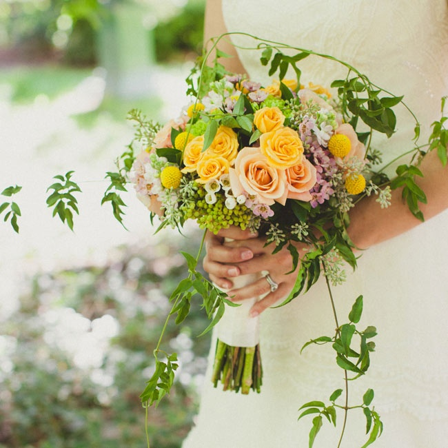 The Bride Carried A Bouquet Of Yellow Garden Roses Mixed With Green