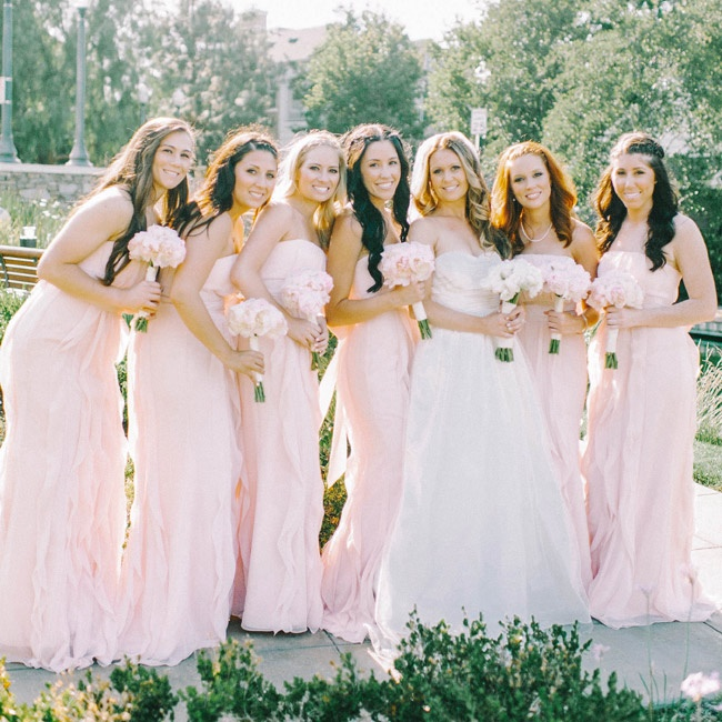 Ashley's bridesmaids wore rose colored Vera Wang dresses and carried matching bouquets.