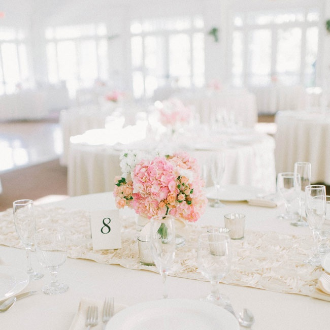 The couple stayed elegant with all white linens with light pink floral decor.
