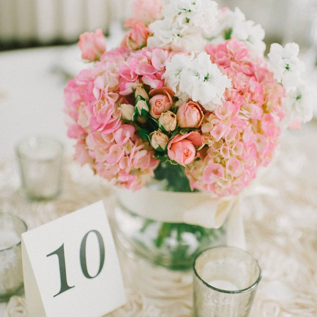 The centerpieces at the reception were filled with pink hydrangeas and white stock flowers.