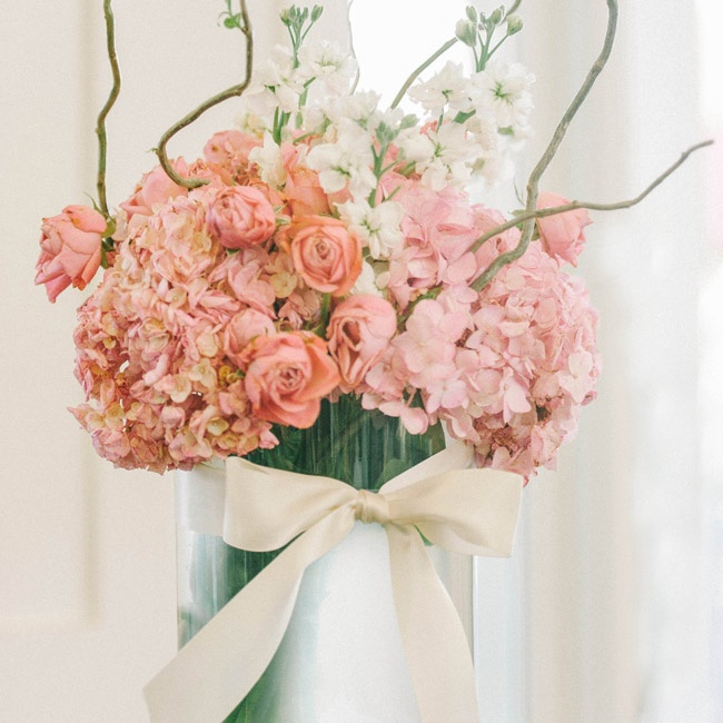 Tall centerpieces at the reception were full of white stock flowers, peach and pink hydrangeas and ranunculuses and vines.
