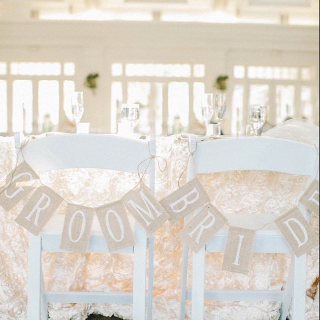 The bride and groom's chairs were designated with burlap signs strung up in twine.