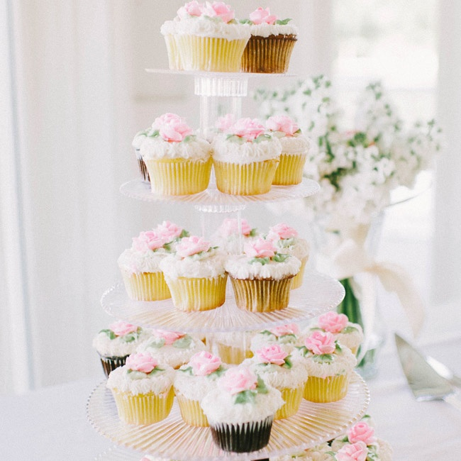 The couple opted for colorful cupcakes with pink floral frosting designs along with their traditional cake.