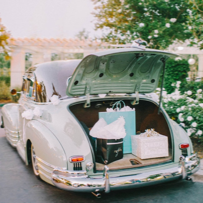The couple exited the reception in this neutral, vintage automobile.