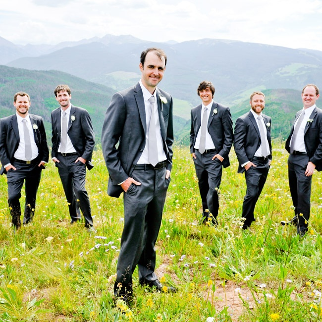 Nick and his groomsmen wore dark gray suits, which they paired with white dress shirts and light gray silk ties.