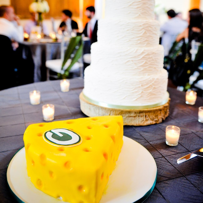 The bright yellow groom's cake was designed to look like a wedge of Swiss cheese and had the Green Bay Packer's logo on the top.