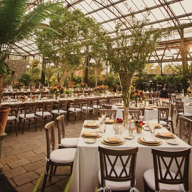 Bright, garden-inspired florals and dark wood chairs came together for an elegant, sophisticated look
