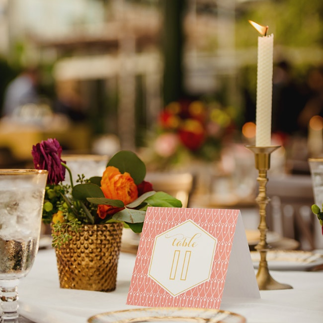 The table numbers had a vintage 1930's appeal with a scalloped Art Deco pattern and bold typeface in coral and gold for a contemporary update.