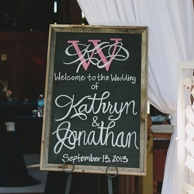 A chalkboard sign in a distressed wooden frame greeted guests as they arrived to the wedding.