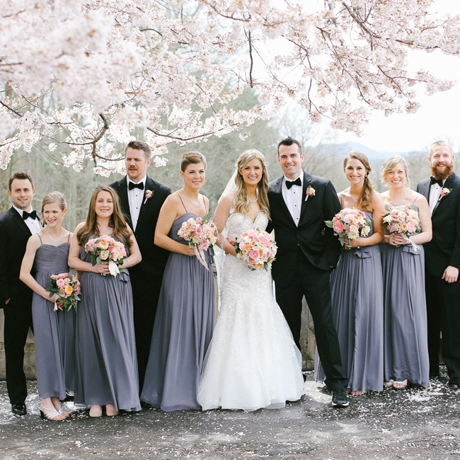 The wedding party stayed neutral, combining the muted slate gray of the bridesmaids Watters gowns with the black formal tuxedos from Men's Wearhosue.